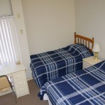 Standard room with double bed and twin bed.